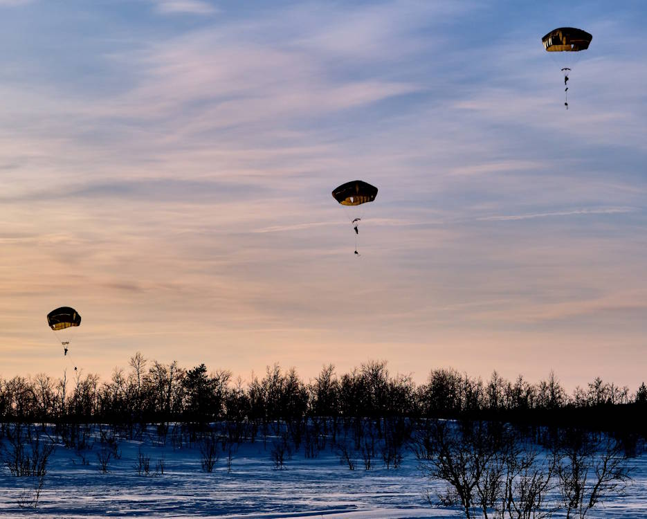 February 27, 2020 - Royal Marines' elite Surveillance and Reconnaissance Squadron (SRS) conduct a parachute insertion from an American C-130J Super Hercules during Exercise Cold Response 20 at Kiruna, Sweden. Ships, helicopters, armored vehicles, commando units, medics, and specialist raiding craft are all committed to the Norwegian-led Exercise Cold Response. In all 15,000 military personnel from ten countries are committed to the demanding winter war games, which will test the abilities of allied nations to fight in one of the most hostile environments on earth. (Courtesy photo by PO Phot Si Ethell)