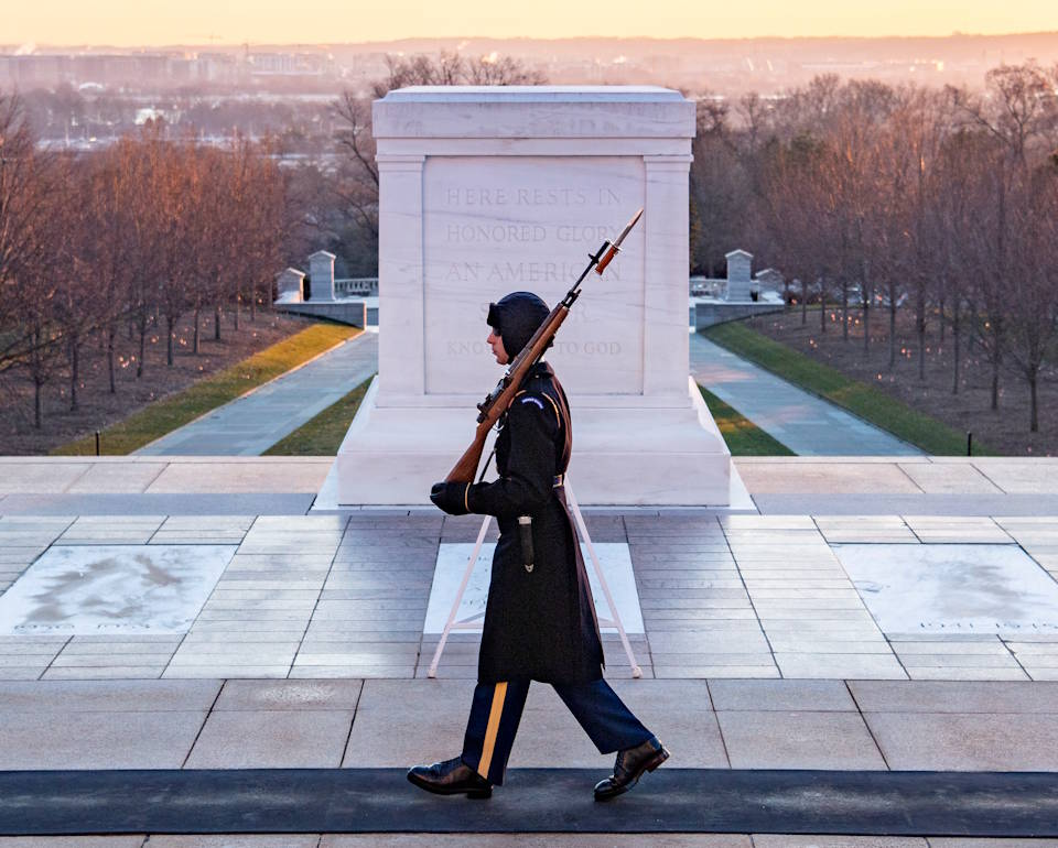 January 22, 2020 - A U.S. Army tomb sentinel walks the mat at the Tomb of the Unknown Soldier early in the cold morning at Arlington National Cemetery, Arlington, Virginia. (Image created by USA Patriotism! from U.S. Army photo by Elizabeth Fraser, Arlington National Cemetery)