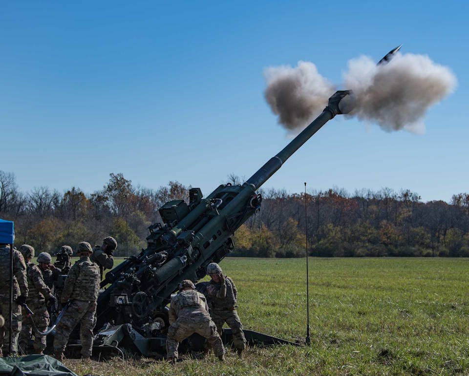 Soldiers with the Indiana Army National Guard conduct a field artillery fire mission during Exercise Bold Quest 20.2 at Camp Atterbury, Indiana on Oct. 31, 2020. Led by the Joint Staff, Bold Quest is a multinational exercise that demonstrates a joint capability to link sensors to shooters across air, land, sea, space and cyberspace. (U.S. Air Force photo by Staff Sgt. Joel Pfiester)