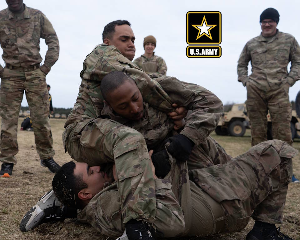 April 6, 2020 - Soldiers assigned to 703rd Brigade Support Battalion, 2nd Armored Brigade Combat Team, 3rd Infantry Division, fight head to head during a two on one combatives training event at Camp Ziemsko, Drawsko-Pomorskie Training Area, Poland. The combatives program test Soldiers on their situational responsiveness to close quarters and threats in a operational environment. (Image created by USA Patriotism! from U.S. Army photo by Spc. Devron Bost)