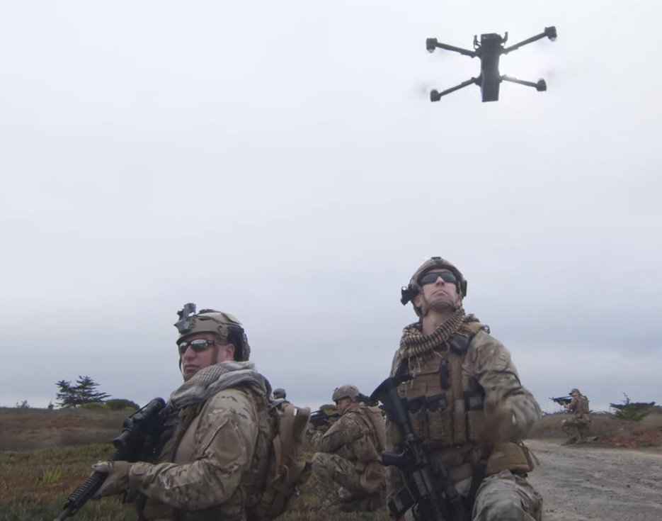 A Skydio small unmanned aerial system hovers above troops conducting a patrol on August 19, 2020. (Photo courtesy of Defense Innovation Unit)
