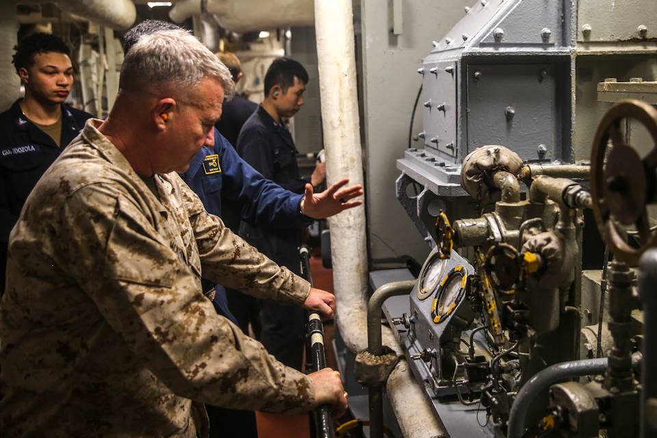 January 23, 2020 - Marine Corps Gen. Kenneth F. McKenzie, commander of U.S. Central Command, tours the main machinery room onboard the USS Bataan, the amphibious assault ship. The Bataan Amphibious Ready Group, with embarked 26th Marine Expeditionary Unit, is deployed to the U.S. 5th Fleet's area of operations in support of maritime security operations to reassure allies and partners and preserve the freedom of navigation and the free flow of commerce in the region. (U.S. Marine Corps photo by Cpl. Tanner Seims)