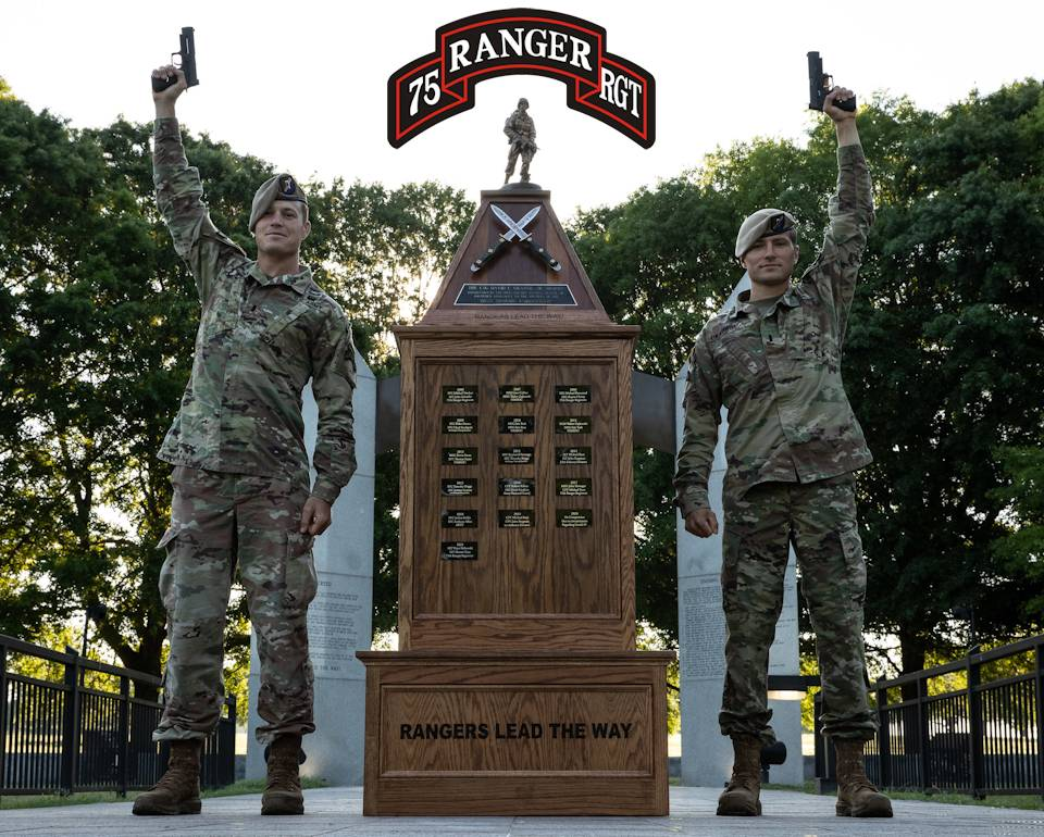 April 19, 2021 - 1st Lt. Alastair Keys (left) and 1st Lt. Vince Palkowski (right), assigned to U.S. Army 75th Ranger Regiment, raise their awarded pistols to the sky as becoming 2021 Best Rangers on Fort Benning, Georgia. The David E. Grange Jr. Best Ranger Competition is a three-day competition that pits the military's best two-person Ranger teams against each other as they compete for the title of Best Ranger. (Image created by USA Patriotism! from U.S. Army photo by Spc. Christian Simmons.)