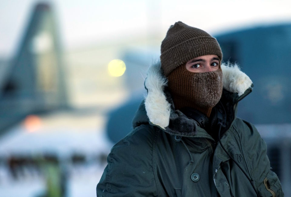 February 8, 2021 - U.S. Air Force Senior Airman Luke Smeltzer, 374th Aircraft Maintenance Squadron crew chief, conducts pre-flight checks on a C-130J Super Hercules during execution day for exercise Arctic Warrior 21 at Joint Base Elmendorf-Richardson, AK. While operating under cold weather conditions, extra checks are needed to be done, to include running auxiliary power unit early to get the aircraft warmed up so the oil can run through the engines efficiently, ensuring the longevity of the engines. (U.S. Air Force photo by Staff Sgt. Gabrielle Spalding)