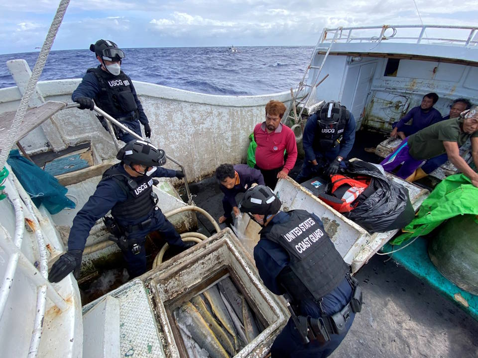 While patrolling approximately 3,600 miles in the Philippine Sea, the Coast Guard Cutter Kimball's law enforcement team conducted its first ever at-sea boarding as the detained crew watches the team's inspection on, Feb. 10, 2021. (U.S. Coast Guard photo courtesy of the Coast Guard Cutter Kimball)