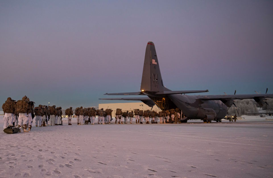 February 8, 2021 - U.S. Army paratroopers, assigned to the 4th Infantry Brigade Combat Team (Airborne), 25th Infantry Division (Spartan Brigade), board a C-130J Super Hercules, assigned to the 36th Airlift Squadron, Yokota Air Base, Japan, during exercise Arctic Warrior 21 at Joint Base Elmendorf-Richardson, AK.  (U.S. Air Force photo by Staff Sgt. Gabrielle Spalding)