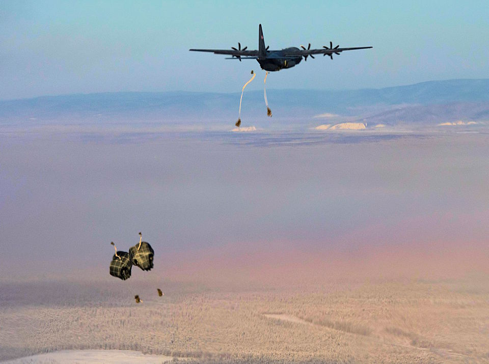 U.S. Army paratroopers, assigned to 3rd Battalion, 509th parachute infantry regiment, 4th Infantry Brigade Combat Team (Airborne), 25th Infantry Division jump out of a C-130J Super Hercules, assigned to the 36th Airlift Squadron, Yokota Air Base, Japan, as part of exercise Arctic Warrior 21 at Donnelly Training Area, AK. (U.S. Air Force photo by Staff Sgt. Gabrielle Spalding)
