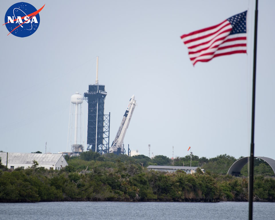 April 16, 2021 - A SpaceX Falcon 9 rocket with the company's Crew Dragon spacecraft onboard is seen as it is raised into a vertical position on the launch pad at Launch Complex 39A as preparations continue for the Crew-2 mission at NASA's Kennedy Space Center in Florida. (Image created by USA Patriotism! from NASA photo by Aubrey Gemignani.)