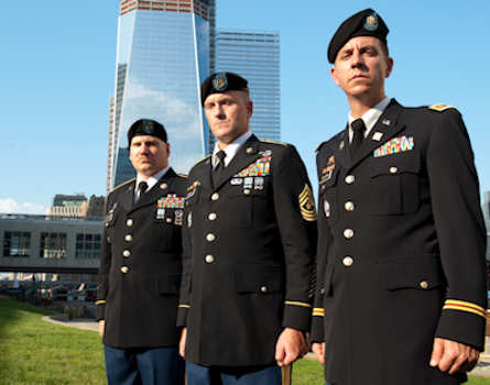 (L-R) Command Sgt. Maj. Christopher Whitford, Maj. Thomas Sullivan and Sgt. Maj. Vincent Mannion stand in front of the Freedom Tower being constructed on the site of the World Trade Center  on August 20, 2011. All three men were all directly affected by the attack on the World Trade Center. Whitford lost his brother, firefighter Mark Whitford with Engine 23 in the South Tower. Sullivan, a financial planner, was in Tower 2 when the second plane struck. He helped survivors escape from the tower before it collapsed. Mannion assisted in search and rescue efforts in the days following the attacks. All three men are in the Army Reserve and have deployed numerous times since 9/11. Photo by Timothy Hale