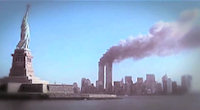 The World Trade Center Towers burning on September 11, 2001 with the Statue of Liberty in the foreground.