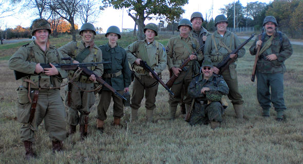 "Branson, MO (November 6, 2010) -- Actors of the ""WWII Remembered"" after their reenactment involving a squad of American soldiers encountering German snipers.  The realistic reenactment occurred on the grounds of the College of the Ozarks after the World War II Veterans reunion. (Photo by USA Patriotism!)"
