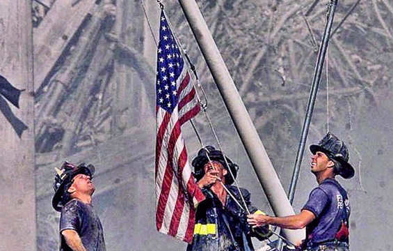 New York firefighters raising flag at Ground Zero shorly after the World Trade Towers collapsed from the terrorist attacks on September 11, 2001.