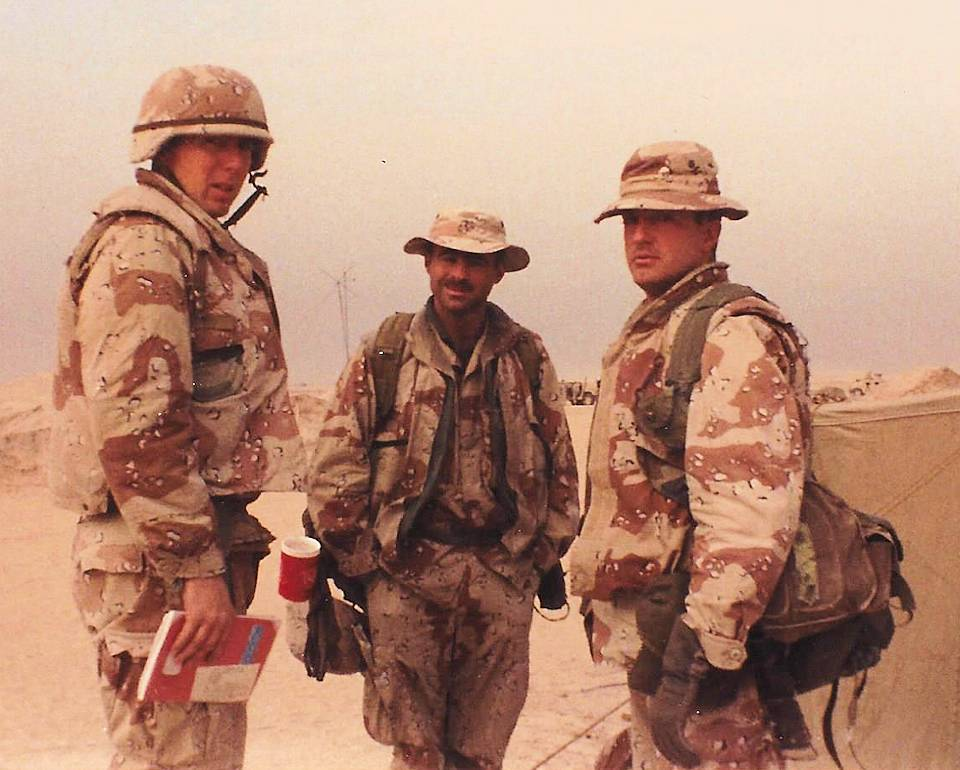 Retired U.S. Marine Lt. Col. John Carretti, left, poses for a photo with fellow Marines during Operation Desert Storm in January 1991. Carretti served with Bravo Company, 1st Battalion, 3rd Marine Regiment, during the operation. (U.S. Marine Corps courtesy photo)