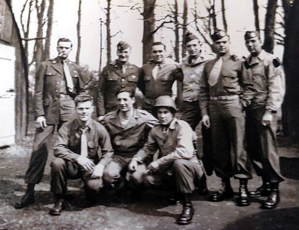Then Army Sgt. Daniel McBride (back row, 2nd from left), assigned to the 502nd Infantry Regiment, 101st Airborne Division, poses with his Army buddies prior to their D-Day jump into France, circa Spring 1944. (Courtesy photo from Daniel McBride)