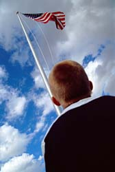 Boy looking up at Old Glory