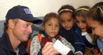 Gary Sinise with Iraqi Children while visiting the troops
