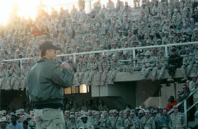 Gary Sinise speaking to troops on a USO tour