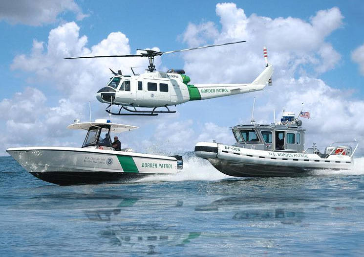 In various colors and sizes, the Racing Stripe became a common emblem for federal, state and local law enforcement and sea service vessels. Such is the case with these Customs and Border Patrol assets. (Photo courtesy of U.S. Customs and Border Patrol)