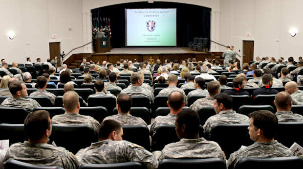 "Soldiers, friends and family members of the 3rd Special Forces Group (Airborne) filled the auditorium of the United States Army John F. Kennedy Special Warfare Center and School in preparation for the group's valor ceremony Sept.15, 2011, in which 30 soldiers from 3rd SFG were honored and awarded respectively: two Silver Stars, seven Bronze Stars with ""V"" device, 10 Army Commendation Medals with ""V"" device and 11 Purple Hearts. U.S. Army photo by Sgt. Enoch Fleites"