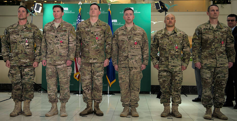 Members of a Special Operations Surgical Team were presented five Bronze Star Medals and a Meritorious Service Medal during a ceremony at The University of Alabama at Birmingham, Alabama, Feb. 13, 2018. The team was recognized for their actions while deployed in support of Operation INHERHENT RESOLVE. SOSTs are surgical teams highly trained in providing life-saving care any time, any place. (U.S. Air Force photo by Staff Sgt. Victor J. Caputo)