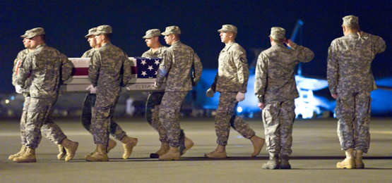 A U.S. Army carry team transfers the remains of U.S. Army Spc. Nicholas P. Bernier of East Kingston, N.H., at Dover Air Force Base, Del., July 3, 2011. Bernier was assigned to the 2nd Battalion, 30th Infantry Regiment, 4th Brigade Combat Team, 10th Mountain Division, based at Fort Polk, La. Photo by U.S. Air Force Roland Balik