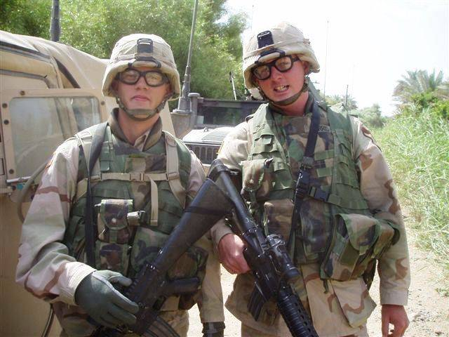 Sgt. Blake A. Harris (right) poses with friend Pfc. Adam Barnes outside of Baghdad in 2005 during their first overseas tour. Harris was killed in action in Baqubah, Iraq, March 5, 2007, by a command detonated improvised explosive device during his second deployment with the 1st Cavalry Division. (Courtesy Photo, 1st ACB Public Affairs, 1st Cav. Division)