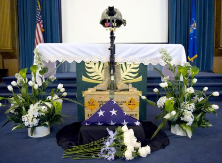Hundreds of people gathered at the base chapel for a memorial service for Senior Airman Michael Buras Oct. 15, 2010, at Nellis Air Force Base, Nev. Airman Buras was an explosive ordnance disposal journeyman assigned to the 99th Civil Engineer Squadron when he was killed in action while responding to a roadside bomb Sept. 21, 2010, in Afghanistan. U.S. Air Force photo by Senior Airman Brett Clashman