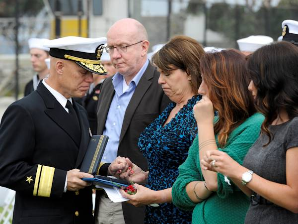 SAN DIEGO (June 13, 2013) Rear Adm. Sean A. Pybus, commander of Naval Special Warfare, presents Diana Pike with a Bronze Star with Valor posthumously awarded to her son Chief Cryptologic Technician (Technical) Christian M. Pike during a memorial service at Naval Special Warfare Support Activity One. Pike, 31, died March 12, 2013 in Landstuhl, Germany, as a result of combat-related injuries sustained on March 10 while conducting stability operations in Maiwand District, Afghanistan. (U.S. Navy photo by Mass Communication Specialist 1st Class Marc Rockwell-Pate)