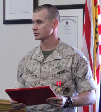 Lt. Col. Guy R. Coursey (left), the installations and environment operations officer with Installations and Environment Department, Marine Corps Base Camp Lejeune, shakes hands with Col. Daniel J. Lecce (right), commanding officer of MCB Camp Lejeune, after receiving the Bronze Star medal during a ceremony at John A. Lejeune Hall aboard the base, Sept. 13. Coursey, an Eagle River, Alaska, native, received the award for his leadership and professionalism while deployed in support of Operation Enduring Freedom.