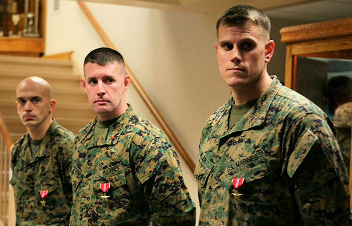 Gunnery Sgt. Eric L. Darmstadt (left), Chief Warrant Officer 3 Chad E. Bacastow (middle), and Capt. Edward H. Miller (right), all formerly with 1st Iraqi Army Division Military Transition Team, II Marine Expeditionary Force (Forward), stand proud after receiving Bronze Stars, during a ceremony held aboard Camp Lejeune, N.C., Jan. 21, 2010. The Marines received their awards for their actions while deployed to Iraq from Sept. 20, 2008 to Sept. 19, 2009.