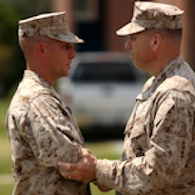First Sgt. Cole Daunhauer, company first sergeant of Utilities Instruction Company at the Marine Corps Engineer School aboard Marine Corps Base Camp Lejeune, shakes hands with Brig. Gen. John Simmons, commanding general of Training Command in charge of MCES, after being awarded the Bronze Star aboard MCB Camp Lejeune on July 18, 2012 for his actions while deployed in support of Operation Enduring Freedom. Daunhauer was deployed with 3rd Battalion, 2nd Marine Regiment from March 1 to Aug. 31, 2011. Photo by USMC Lance Cpl. Scott Whiting