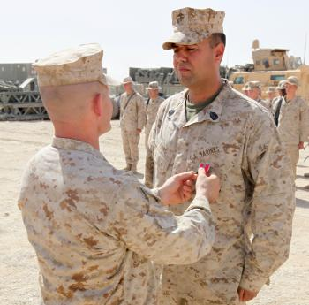 Lt. Col. Ted A. Adams (left), the commanding officer of 9th Engineer Support Battalion, 1st Marine Logistics Group (Forward), presents the Bronze Star to Gunnery Sgt. Eric J. Fears, the staff non-commissioned officer in charge of Bridge Platoon, Alpha Company, 9th ESB, 1st MLG (FWD), at Camp Leatherneck, Afghanistan, Oct. 3, 2010. Fears, 34, from Blue Ridge, Ga., received the award for his strong leadership while conducting counter improvised explosive device operations while supporting the International Security Assistance Forces in Afghanistan.