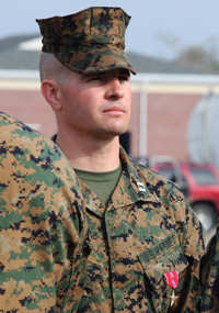 Capt. Brandon J. Gorman, who served as Echo Company commander, 2nd Battalion, 2nd Marine Regiment in Afghanistan, stands at attention after he received a Bronze Star Medal with Combat Distinguishing Device from Lt. Gen. John M. Paxton, commanding general, II Marine Expeditionary Force, during a ceremony aboard Marine Corps Base Camp Lejeune, Feb. 28, 2011.