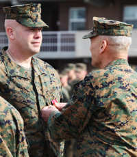 Sgt. Maj. William E. Heyob, battalion sergeant major for Battalion Landing Team, 2nd Battalion, 2nd Marine Regiment, 22nd Marine Expeditionary Unit, receives a Bronze Star Medal with Combat Distinguishing Device from Lt. Gen. John M. Paxton, commanding general, II Marine Expeditionary Force, during a ceremony aboard Marine Corps Base Camp Lejeune, Feb. 28, 2011.