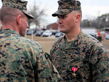 Lieutenant Colonel Daniel A. Schmitt, the battalion commander for 3rd Battalion, 6th Marine Regiment, 2nd Marine Division, presents the Bronze Star with combat distinguishing device to Sgt. Marcus B. Holan, Feb. 3, 2010 aboard Marine Corps Base Camp Lejeune. It was about the Marines out there, said Holan. Without the supporting arms we wouldn't have made it. We were just doing what we had to do.