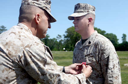 Gunnery Sgt. Robert L. Jernigan, of Gates County, N.C., receives the Bronze Star Medal with Combat Distinguishing Device from Maj. Gen. Michael G. Dana, the 2nd Marine Logistics Group commanding general, during a ceremony aboard Camp Lejeune, N.C., May 2, 2012. While serving as a joint terminal attack controller attached to 2nd MLG (Forward) in Afghanistan last year, Jernigan's expert control of air assets was directly responsible for quelling an ambush and undoubtedly saved countless lives. U.S. Marine Corps photo by Cpl. Jessica Gonzalez