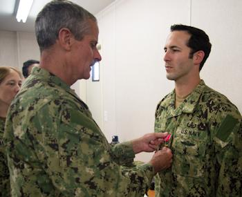 "Rear Adm. Michael Tillotson, commander, Navy Expeditionary Combat Command (NECC), presents the Bronze Star Medal with Combat ""V"" to Explosive Ordnance Disposal Technician 1st Class Johnny J. Novela during an award ceremony at Explosive Ordnance Disposal Mobile Unit 2 on Joint Expeditionary Base Little Creek-Fort Story (JEBLC-FS), June 18, 2013. Novela was awarded the bronze star for heroic achievements while assigned to a joint task force in support of operation Enduring Freedom in Afghanistan. (U.S. Navy photo by Mass Communication Specialist 3rd Class Randy Savarese)"