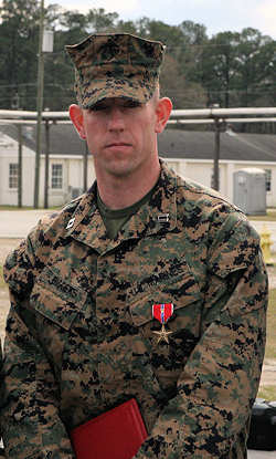 Capt. Joshua Biggers, executive officer of the Infantry Training Battalion, School of Infantry - East, stands after receiving the Bronze Star Medal with V following his award ceremony aboard Camp Geiger, March 11, 2011. As commanding officer of Company K, 3rd Battalion, 6th Marine Regiment, Regimental Combat Team 7, 1st Marine Division (Forward), in Marjah, Afghanistan, Biggers displayed multiple acts of heroism in leading his Marines and sailors during the six-month Operation Moshtarak.