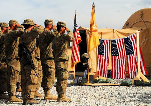 Soldiers of 1st Squadron, 113th Cavalry Regiment, Task Force Redhorse, 2nd Brigade Combat Team, 34th Infantry Division, TF Red Bulls, hold a salute while the national anthem is played during a memorial service for U.S. Army Staff Sgt. James A. Justice, a squad leader for 1st Platoon, Troop A, 1st Sqdn., of Grimes, Iowa, at Joint Combat Outpost Pul-e Sayad, Afghanistan, April 25, 2011. Justice was killed in action in Kapisa province during a recovery mission of a downed aircraft April 23, 2011. Photo by Army SSgt. Ashlee Lolkus