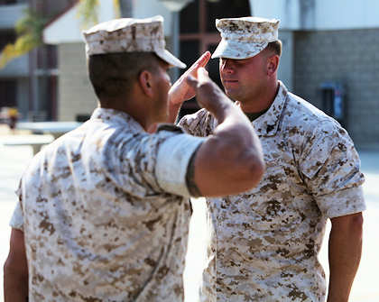 "Sergeant Ryan M. Krochmolny, machine gun section leader, Kilo Company, 3rd Battalion, 5th Marine Regiment, 1st Marine Division, salutes 1st Lt. Victor M. Garcia, Kilo Company's executive officer, during his award ceremony, Sept. 1, 2011, for the Bronze Star with Combat ""V"" he earned while serving under Garcia in Sangin, Afghanistan. Marine Corps photo by Lance Cpl. Timothy J. Lenzo"