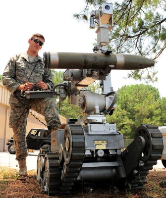 Senior Airman Joshua Labott, 20th Explosive Ordnance Disposal apprentice, shows off the capabilities of the Remote Operated Neutralizer System, June 11, 2010. Photo by Senior Airman David Minor