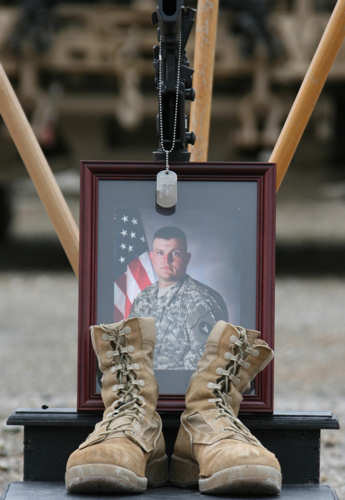 A photo of U.S. Army Sgt. Brent M. Maher, along with his boots, rifle and dog tags, is displayed at his memorial service on Combat Outpost Dand Patan April 18. Maher, an infantryman with 1st Battalion, 168th Infantry Regiment, 2nd Brigade Combat Team, 34th Infantry Division, Task Force Lethal, was killed when an improvised explosive device detonated under his truck in Paktya province, Afghanistan, April 11, 2011. Photo by U.S. Army Sgt. John P. Sklaney III