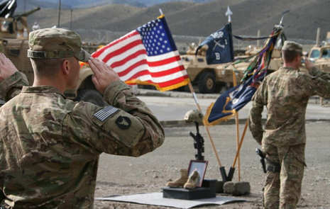 U.S. Army 1st Sgt. Christopher Casey of Neola, Iowa, the senior enlisted soldier of Company B, 1st Battalion, 168th Infantry Regiment, 2nd Brigade, 34th Infantry Division, Task Force Lethal, renders a final salute to U.S. Army Sgt. Brent M. Maher an infantryman with Co. B, at a memorial ceremony on Combat Outpost Dand Patan, Afghanistan, April 18, 2011. Photo by U.S. Army Sgt. John P. Sklaney III