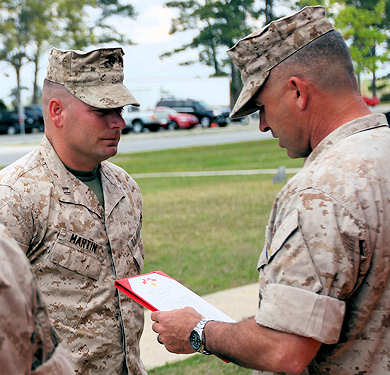 Captain Matthew J. Martin, the Operations Officer for 2nd Marine Regiment, 2nd Marine Division, receives a Bronze Star with combat distinguishing device from Col. Paul J. Kennedy, the 2nd Marine Regiment Commander, aboard Marine Corps Base Camp Lejeune, N.C., April 08, 2011. This was Martin's second time receiving the nation's fourth-highest award with combat distinguishing device.