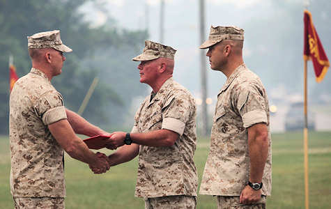 Brig. Gen. W. Lee Miller Jr., the acting commanding general for 2nd Marine Division presents the Bronze Star award citation to Gunnery Sgt. Chad L. Miller the radio chief for 5th Battalion, 10th Marine Regiment, 2nd Marine Division, aboard Marine Corps Base Camp Lejeune, N.C., June 29, 2011.Miller was awarded the Bronze Star with combat distinguishing device for his heroic action in Kunar Province, Afghanistan in 2009.