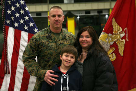 1st Sgt. Anthony J. Pompos, first sergeant for Ordnance Maintenance Company, 2nd Maintenance Battalion, 2nd Marine Logistics Group, poses for a photo with his family during a ceremony aboard Camp Lejeune, N.C., Feb. 23, 2011, where he was awarded the Bronze Star Medal. Pompos joins this elite group of service members for his heroic service in connection with combat operations against the enemy while serving as first sergeant for Bravo Company, 1st Battalion, 6th Marine Regiment, Marine Expeditionary Brigade - Afghanistan, on Feb. 13, 2010, in support of Operation Enduring Freedom.