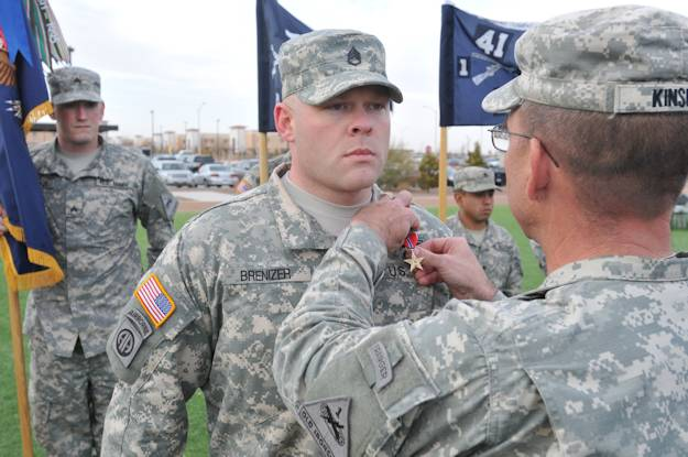 Staff Sgt. Robert Brenizer receives his Bronze Star for Valor from 1st Battalion, 41st Infantry Regiment Commander Lt. Col. William Kinsey at an awards ceremony on Jan. 11, 2013. (U.S. Army photo by Sgt. Patrick Doran)