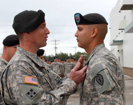 Army Sgt. Stephen Stoops receives the Bronze Star with Valor from Col. Reed on July 23, 2012. Photo by Army Sgt. Michael Blalack