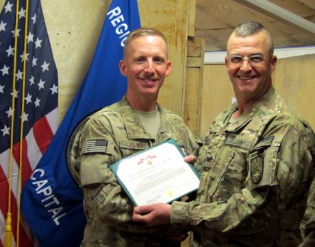 RSC-Capital Commander Col. Arthur G. Weeks III presents Capt. Christopher T. Tusing with the Bronze Star Medal while the 167th Airlift Wing airman was on deployment in Afghanistan. Photo Courtesy of Capt. Christopher T. Tusing