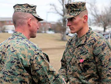 Lieutenant Colonel Daniel A. Schmitt, the battalion commander for 3rd Battlion, 6th Marine Regiment, 2nd Marine Division, presents the Bronze Star with combat distinguishing device to Staff Sgt. Christopher J. Whitman, Feb. 3, 2010 aboard Marine Corps Base Camp Lejeune. All I was, was an enabler for Marines to do what they've done forever, said Whitman. I just happen to be the one who gets to wear what the 39 other people in my platoon deserve.